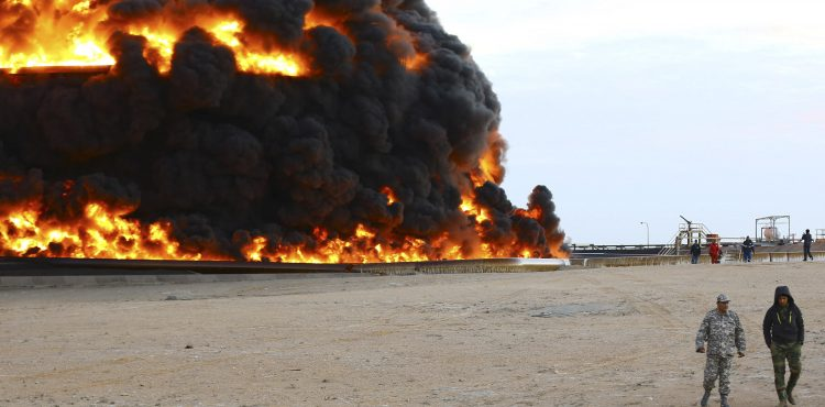 WAR-TORN LIBYA FIGHTS FOR ITS FUTURE ONE BARREL AT A TIME